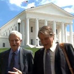 Photo of I. M. 'Mac' Destler and Steven Kull in front of the Virginia State Capitol building.